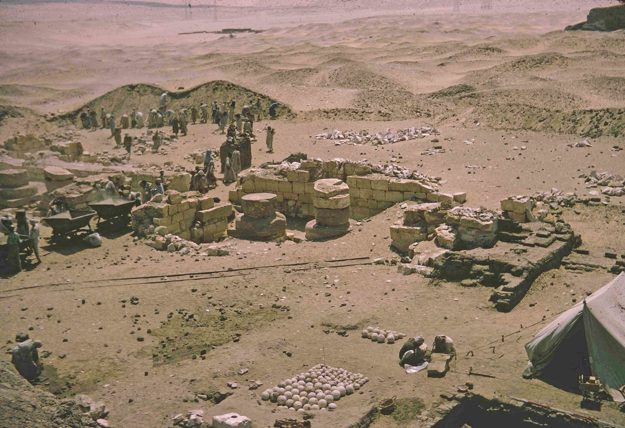 "Fig. 4. The Penn-Yale excavations, directed by David O'Connor and William Kelly Simpson, at the ""Portal"" Temple of Ramses II during the Expedition's first season at Abydos in 1967. The excavated stockpile of ballista ammunition probably dating to the Theban revolt c. 199 BCE is visible in the foreground. Photo: David O'Connor © North Abydos Expedition (formerly Penn-Yale-IFA), courtesy of the Penn Museum."