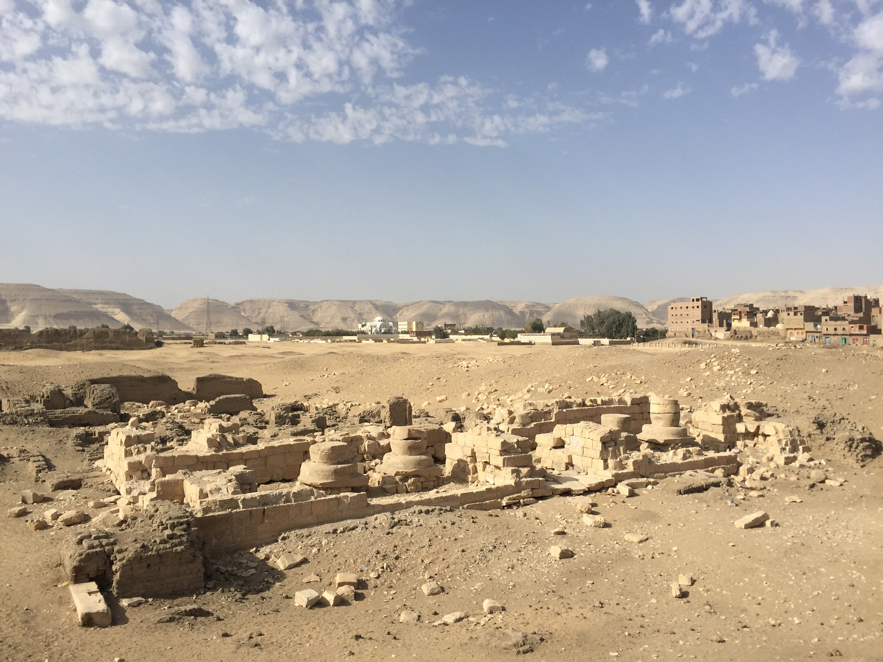 "Fig. 11. The ""Portal"" Temple of Ramses II as it stands today, with the modern Coptic Christian community of Deir Sitt Damiana behind it to the northwest. Photo: Wendy Doyon © North Abydos Expedition 2019"