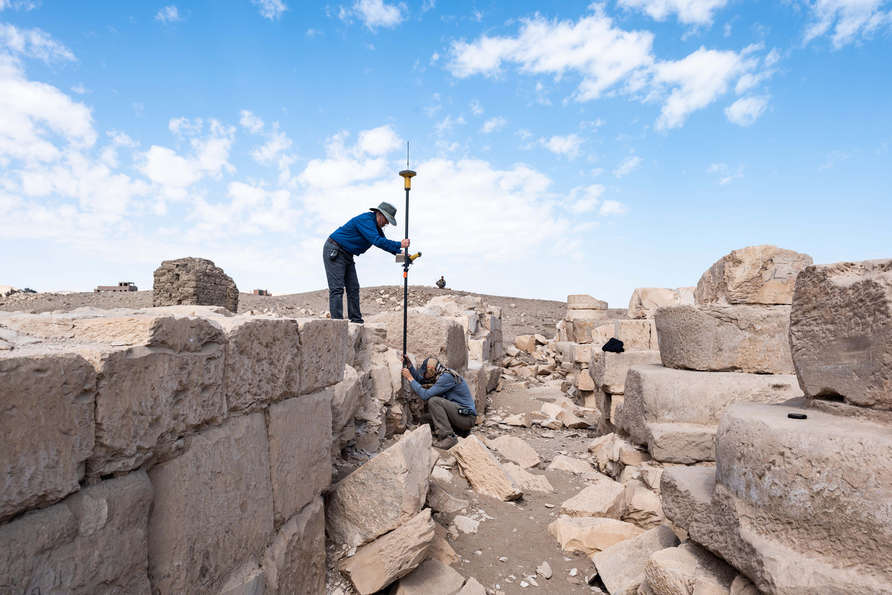Fig. 15. Archaeologist Jo Young mapping the footprint of the temple's walls using GPS. Photo: Ayman Damarany © North Abydos Expedition 2019