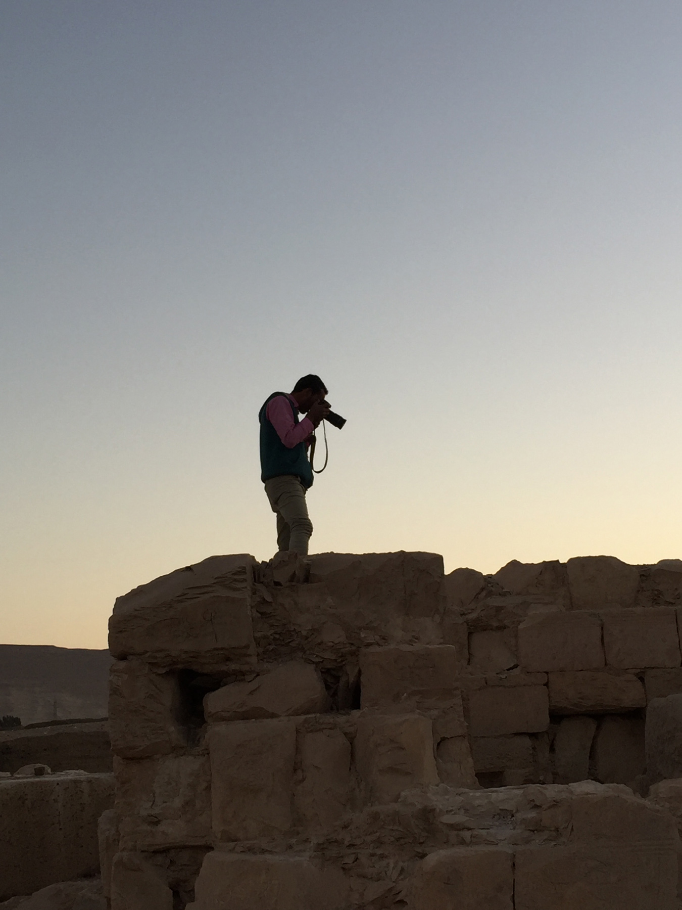 Fig. 16. Ayman Damarany photographing the temple. Photo: Wendy Doyon © North Abydos Expedition 2019