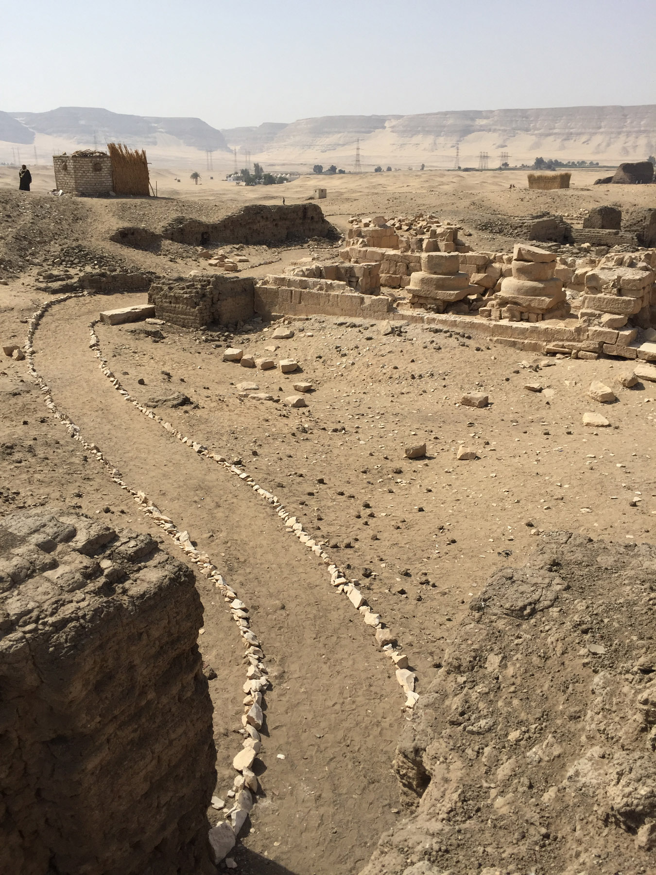 "Fig. 18. Section of the new footpath guiding visitors through the ancient enclosure wall, around the ""Portal"" Temple of Ramses II, and on into the funerary landscape beyond. Photo: Wendy Doyon © North Abydos Expedition 2019"