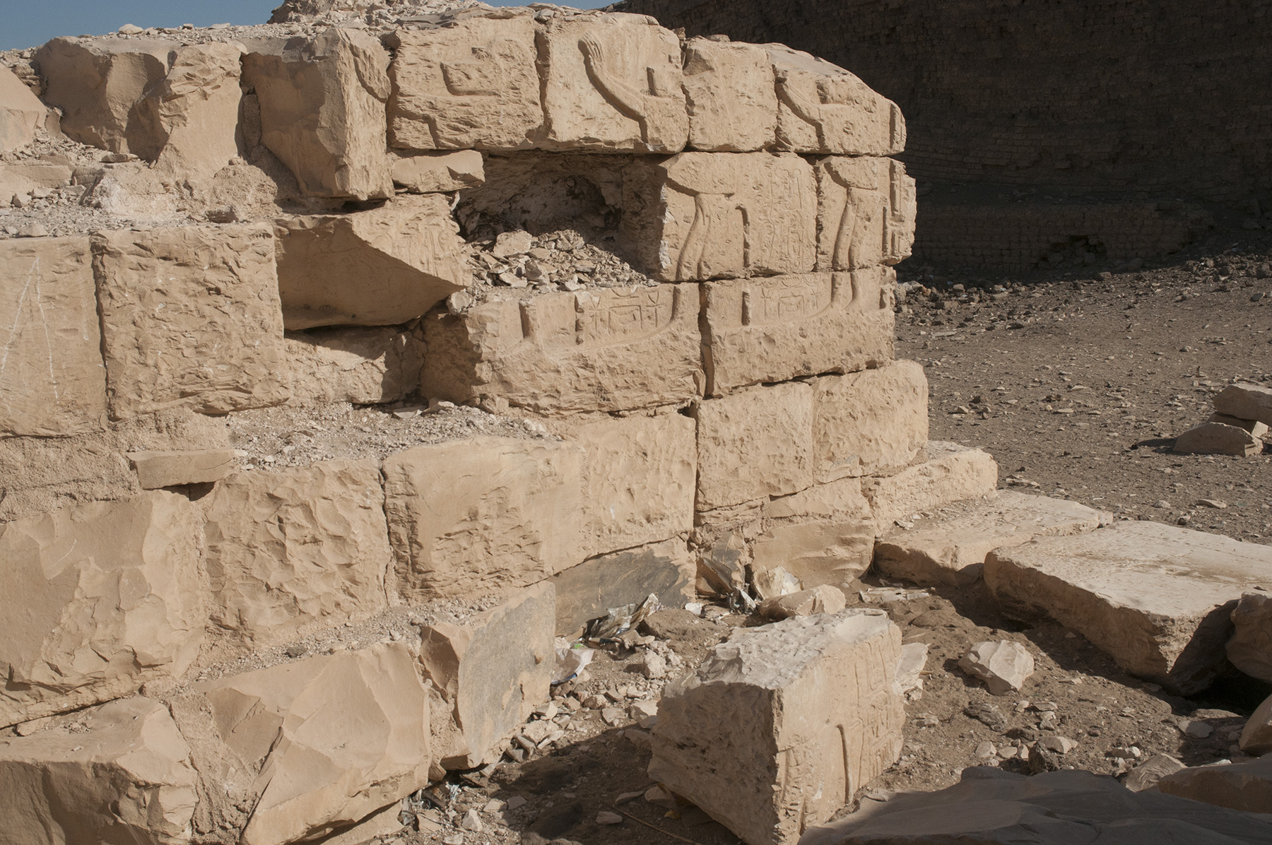 Fig. 12. Detail of a relief block pried out of the northern wall of the central passageway along the temple's main axis, where it lay discarded by vandals until it could be moved into secure storage in 2018, now awaiting its future restoration to the wall. Photo: Matthew Adams © North Abydos Expedition 2018