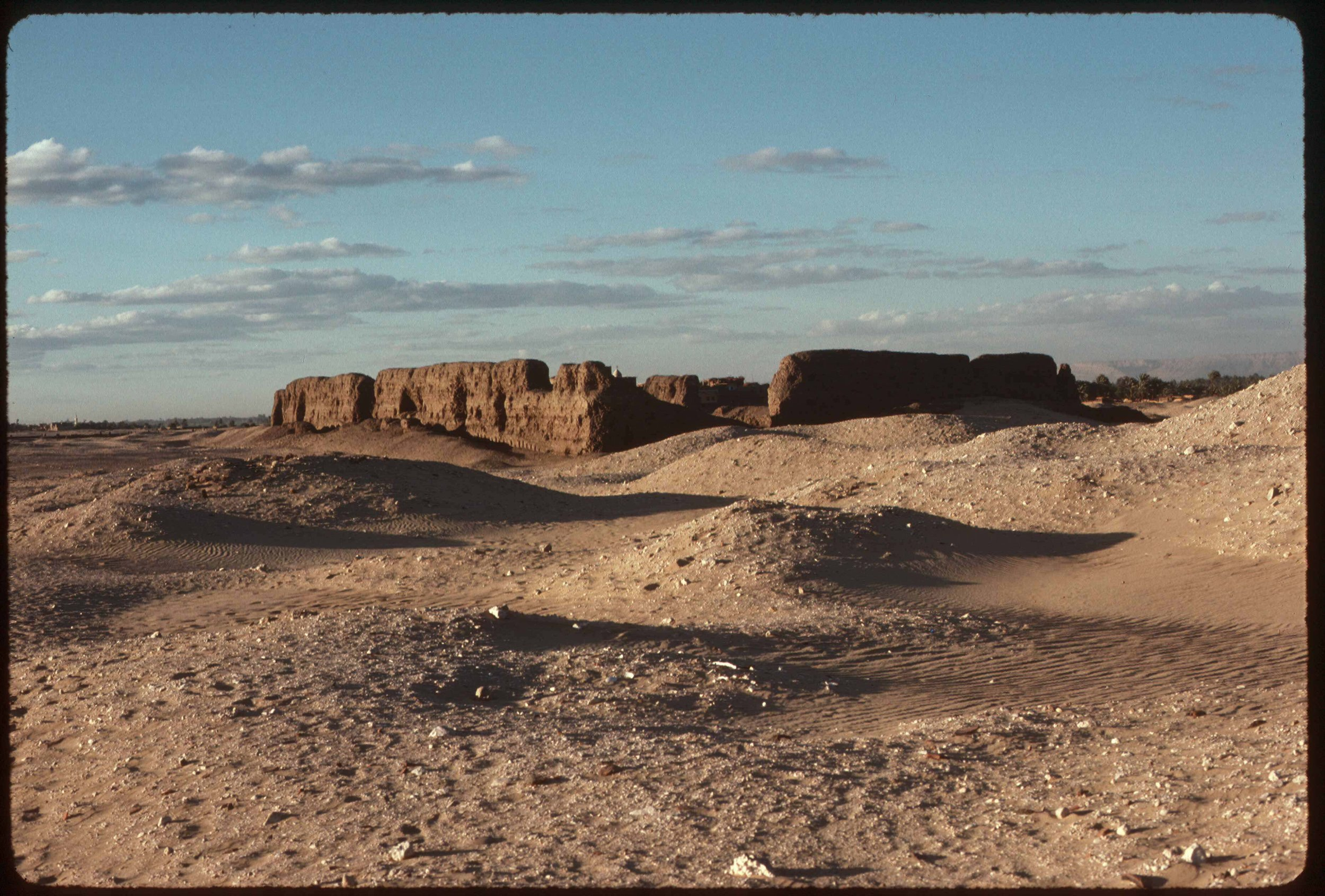 Fig. 1. Second Dynasty cult enclosure of King Khasekhemwy (c. 2700 BCE) — the Shunet el-Zebib, looking north at sunset, 1988. Photo: David O'Connor © North Abydos Expedition (formerly Penn-Yale-IFA), courtesy of the Penn Museum