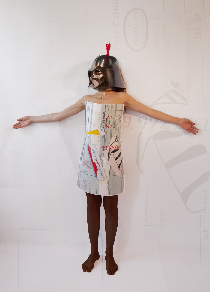 The paper dress I am wearing is a 30 x 40 inches mixed media collage over a c-print of my Lucasfilm W2: