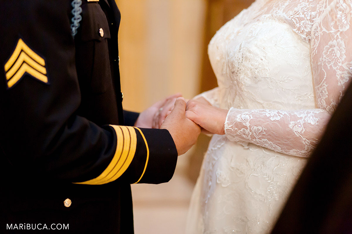 Bride and groom are holding hands in the ceremony in the SF CIty Hall, California
