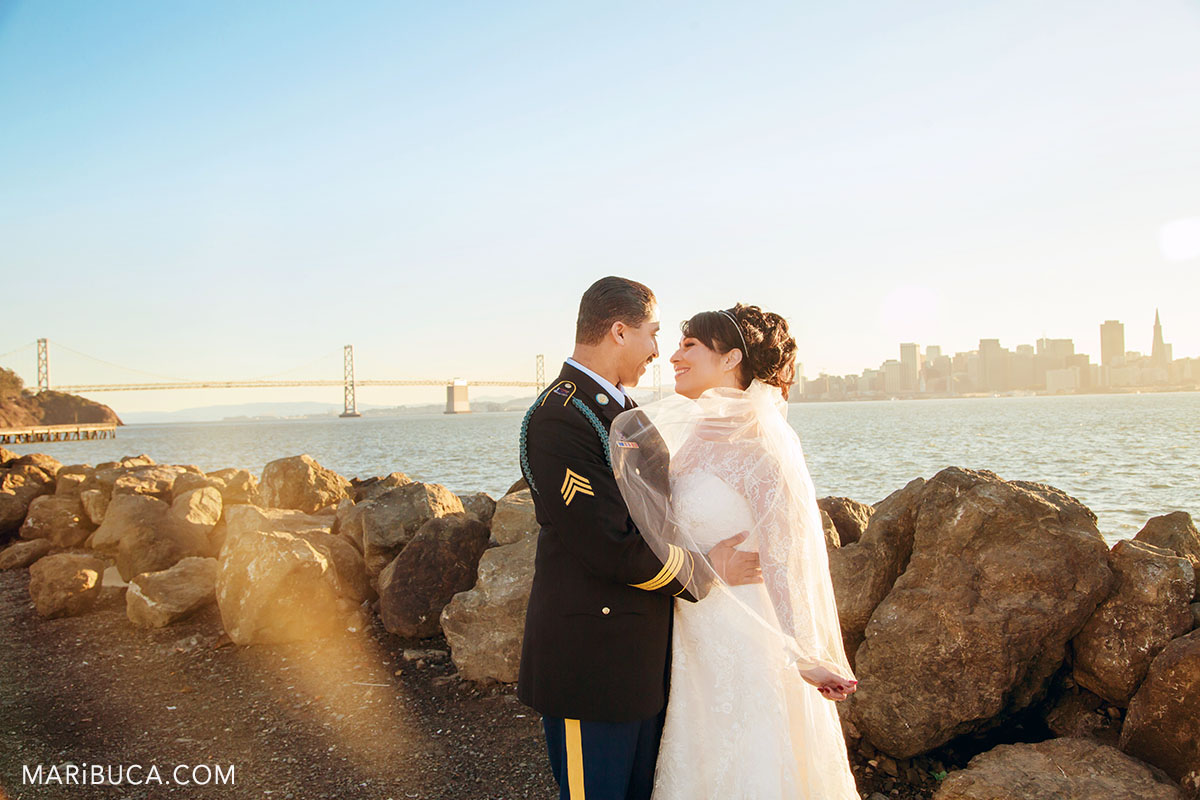 the bride and the groom look each other in the Treasure Island during sunset time.