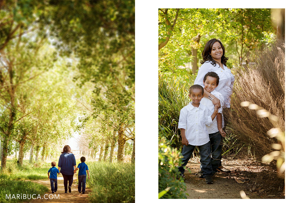summer time for walking with kids, Mom and her kids walking in the arch trees.