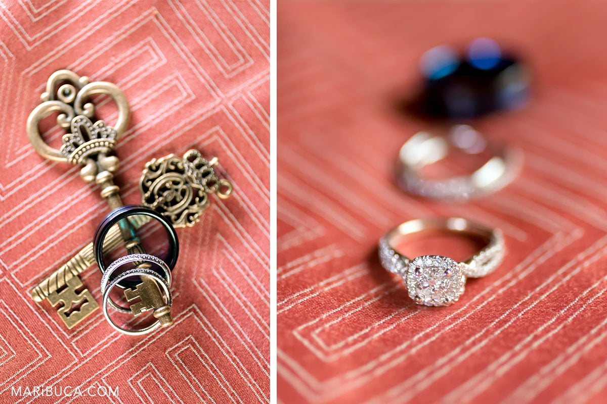 wedding details such as wedding rings and engagement ring in the blush background
