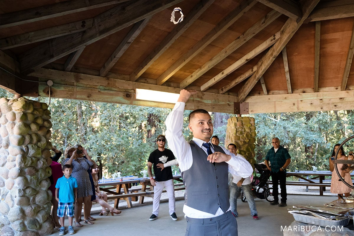 the groom throws the garter to groomsmen