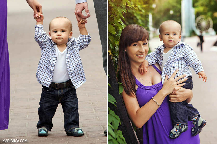 10 month baby boy already dcan walking and he looks modern with his in plaid shirt. Mother holds baby son and smiles.