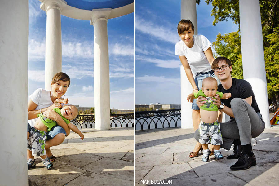 Parents and young son and enjoyed posing against white columns and blue sunny sky.