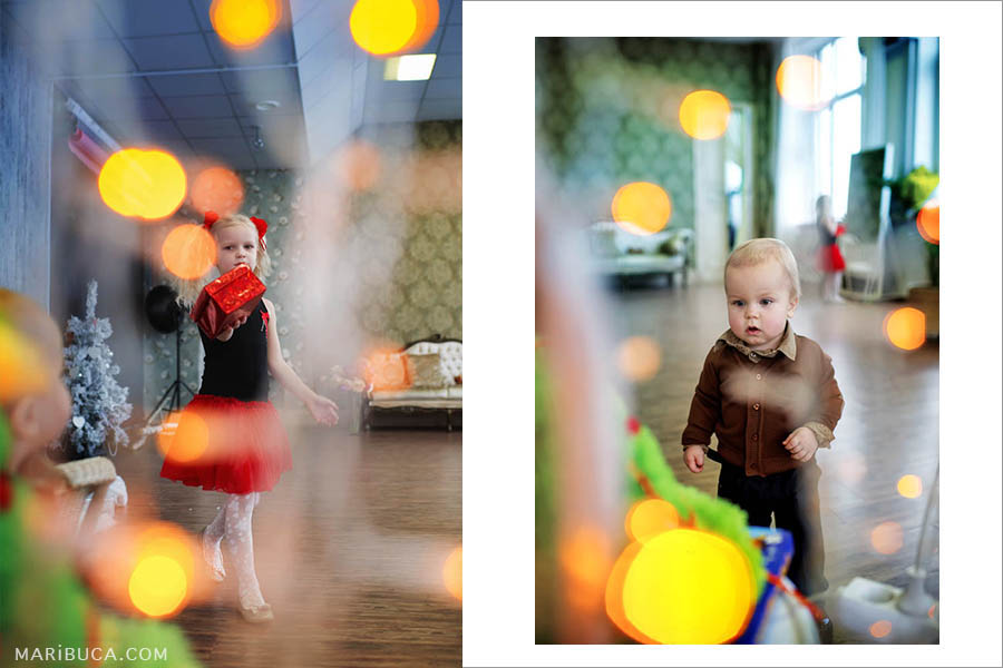 a five-year-old girl in a black T-shirt and a red skirt and a one-year-old boy in orange lights