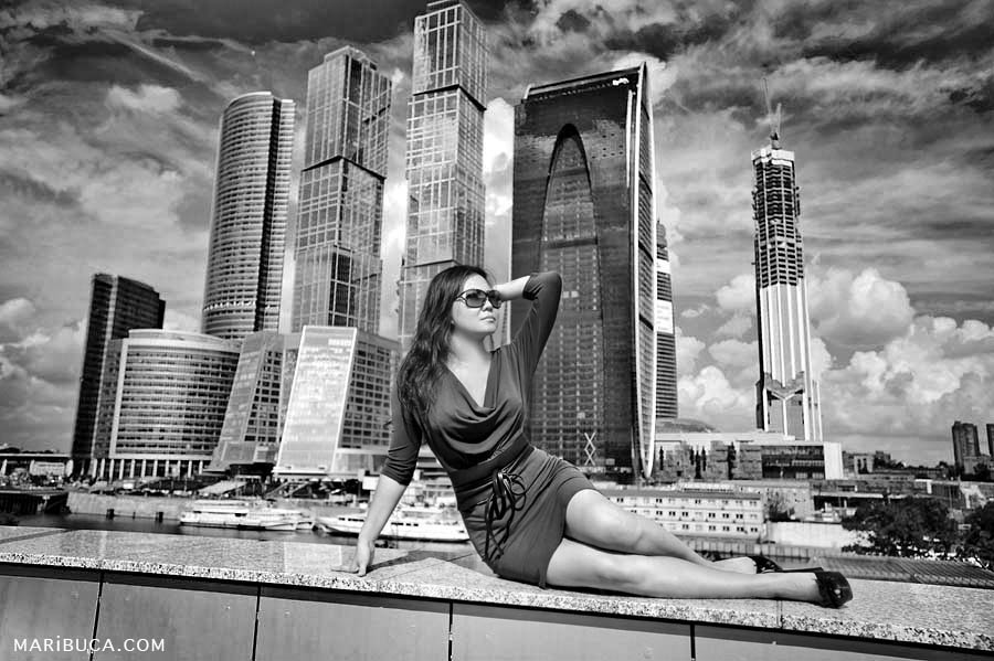 black and white photo of a girl on the background of skyscrapers in downtown san francisco