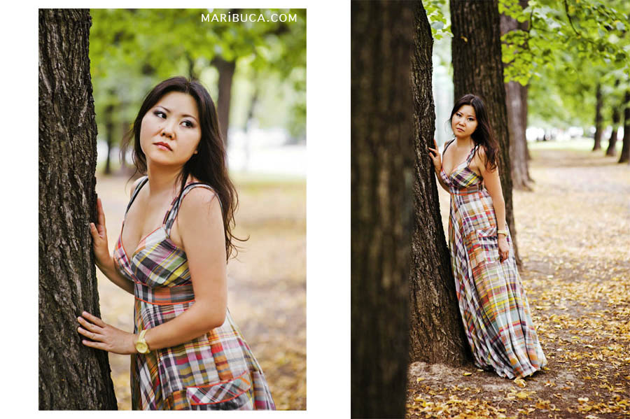 Portrait of a girl in a long dress in warm tones walking through the park in autumn in Vasona Park