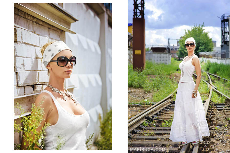 Industrial view of abandoned rails and girls standing in a white T-shirt and white long skirt in Campbell.