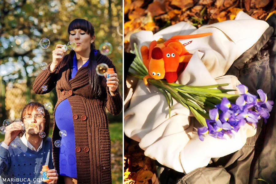 Future parents blow bubbles on a sunny autumn day. Details: Soft orange dog toys hold vibrant purple flowers irises.