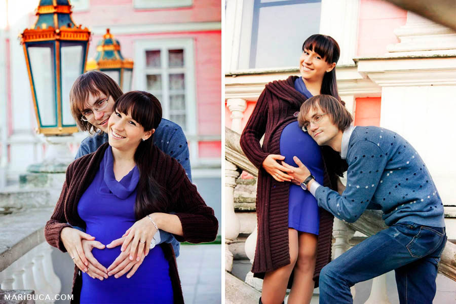 Man and pregnant woman are kept his hands on her abdomen as the heart and laugh.