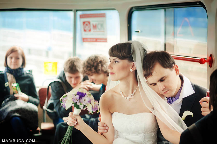the bride and groom ride public transport on a tram to the registry office in San Francisco.