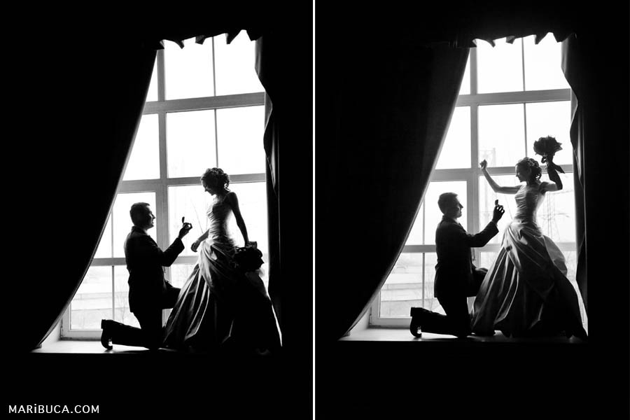 """black and white photographs of the silhouette of the bride and groom standing on the windowsill and the groom pulls out a ring for his beloved bride, the bride rejoices and says """"yes"""" at San Francisco City Hall."""