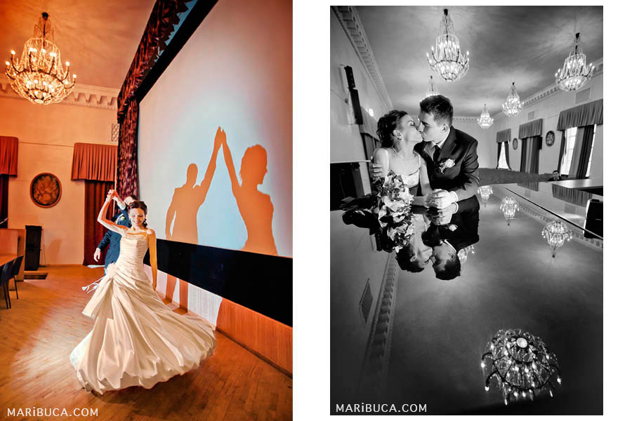 Bride and groom are dancing in a room in orange tones. Newlyweds kiss each other and you can see the reflection from the piano.