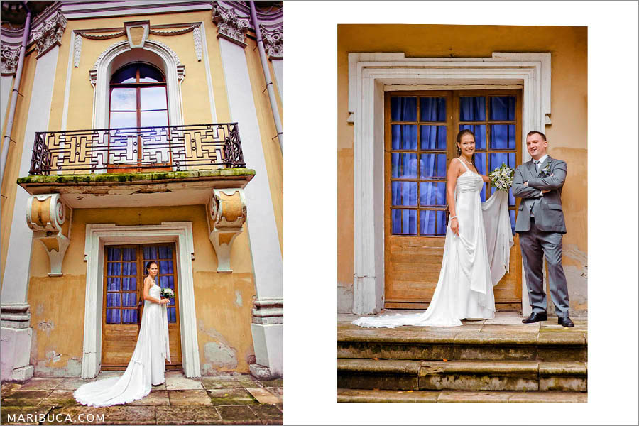 The bride stands against the yellow textured yellow old historic building, the bride and groom stand against the background of the door with purple curtains.