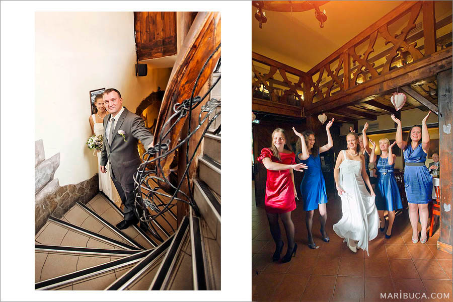 Groom and bride stand in the staircases. Bride with bridesmaids dancing in the barn.