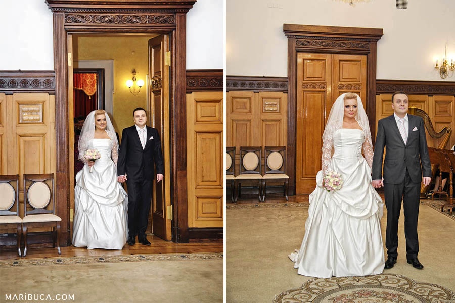 Bride and groom enter in the marriage registration hall.