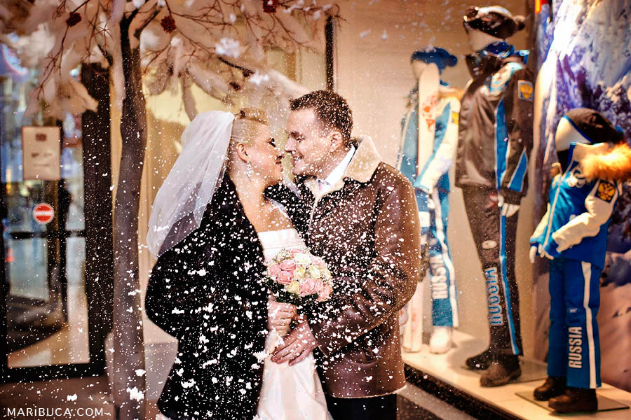 Bride and groom are having fun and enjoy each other with the snow :)