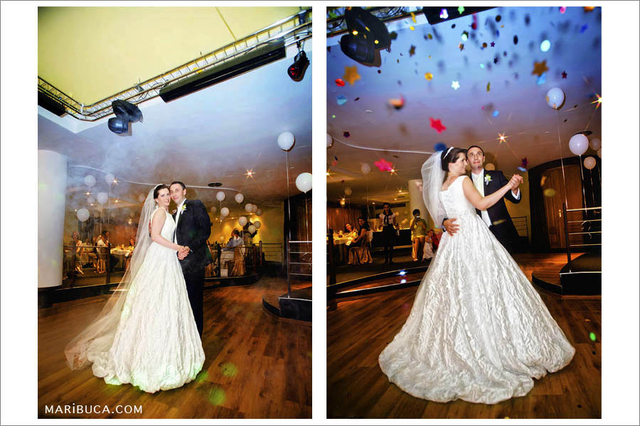 n the first dance of the newlyweds, the guests throw up colored paper up in the reception.