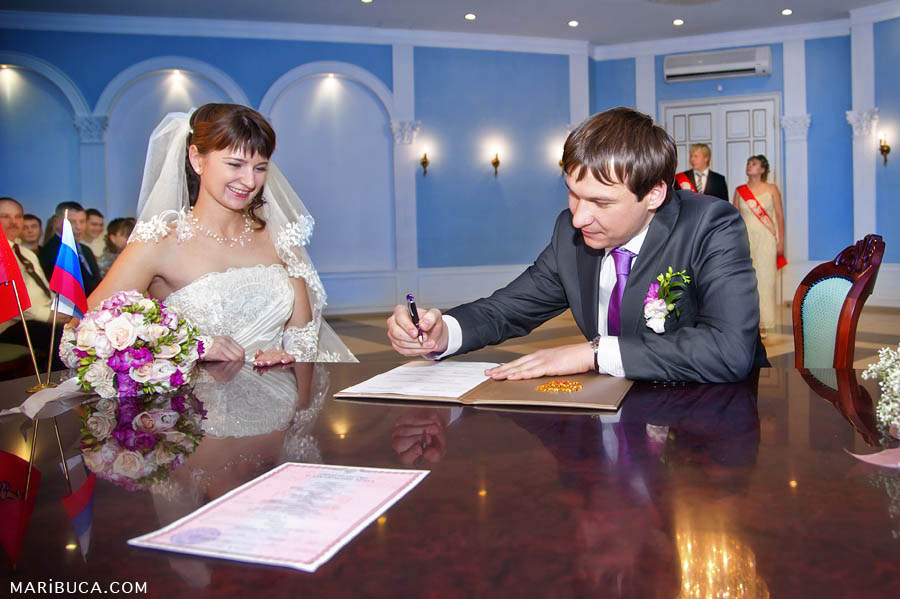 the groom signs the marriage registration hall