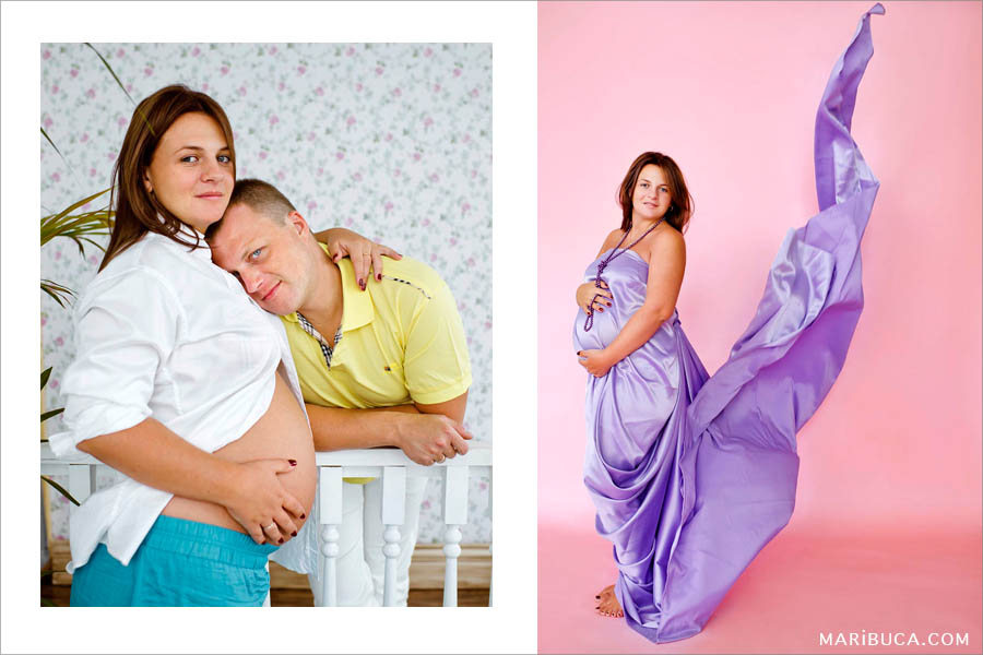 Family maternity portrait, they are expecting the baby girl. Pregnant girl with her purple fly dress and pink background..