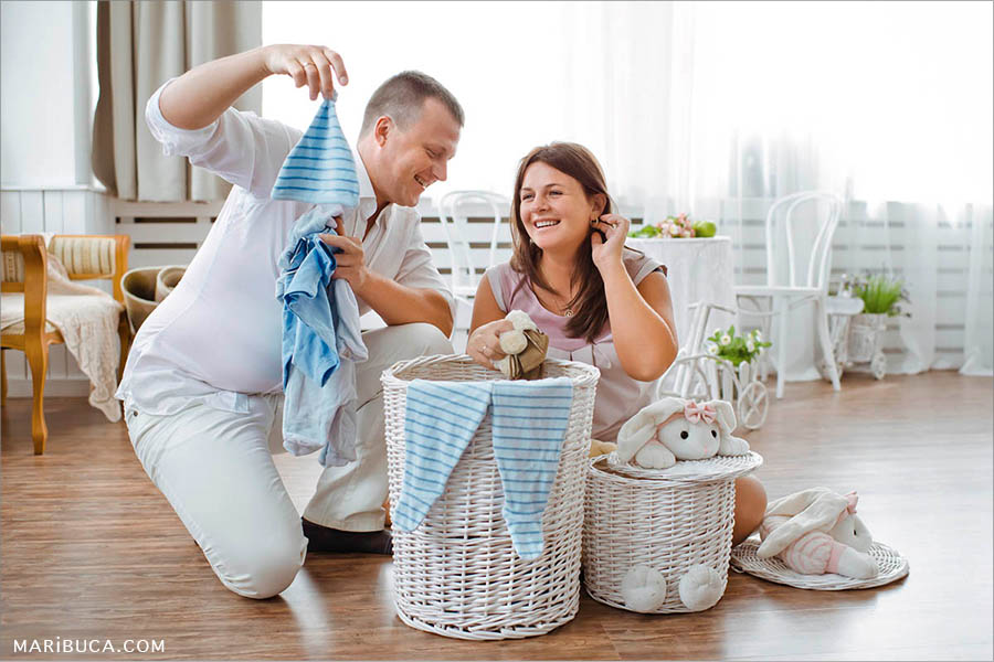 Who will try on baby clothes? Answer: only future mom and dad who is expecting the baby.