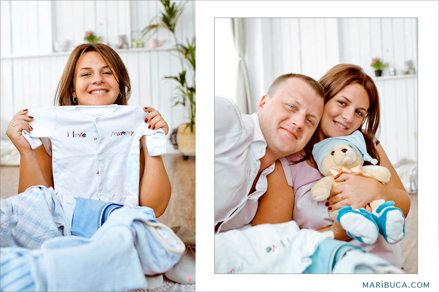 Happy smiling family to show their props for the future baby.