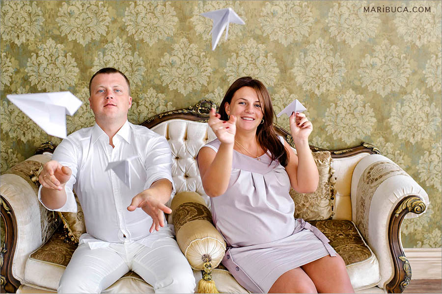 The family are expecting first child and having fun just launching-the paper airplanes