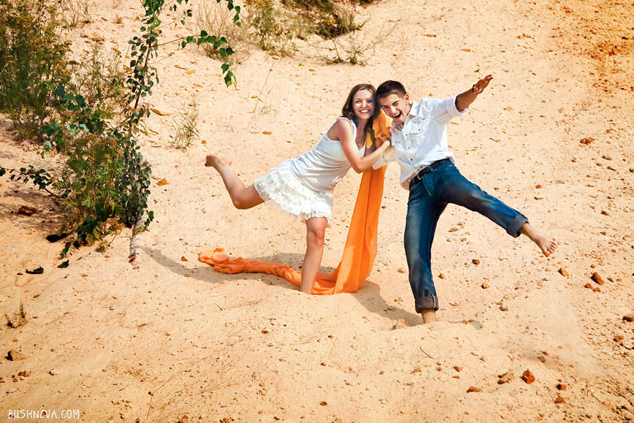 A couple having fun in the yellow sand area