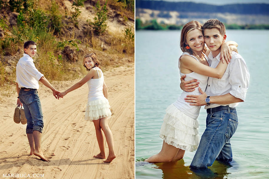 The girl and the guy walk barefoot on the yellow sand, hold hands and turn around to the wedding photographer at Bay Aria.