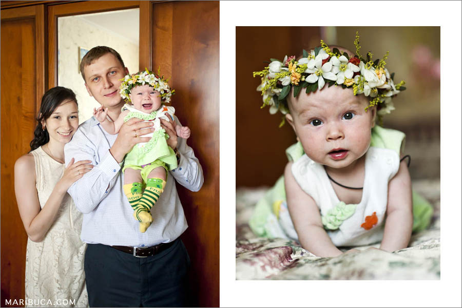 mom, dad and their cute five-month-old daughter with a wreath on her head are photographed together at home