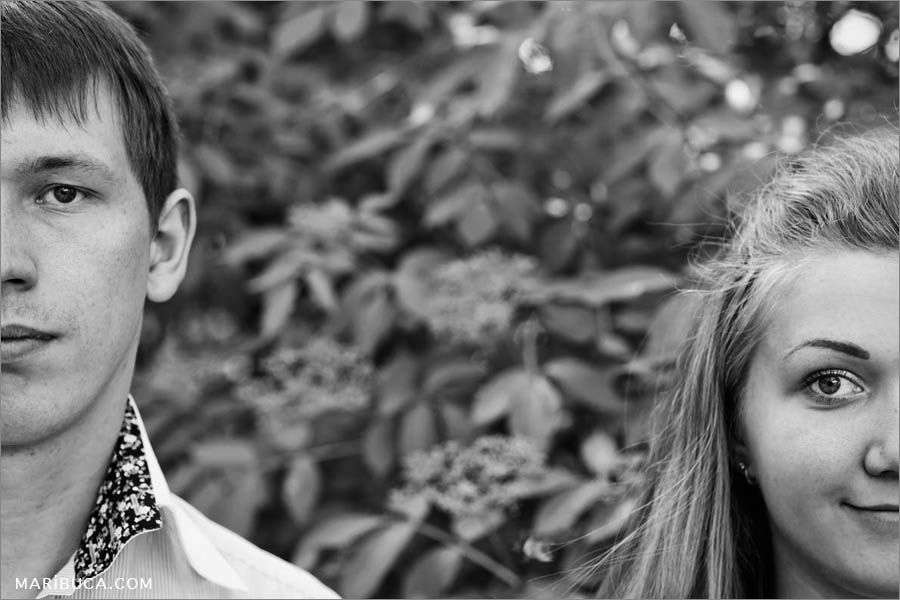 Image of the guy and girl as the couple and half face in the picture during an engagement photo session.