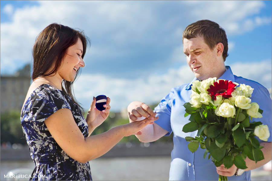 The guy put the ring on the his fiancee finger during engagement.