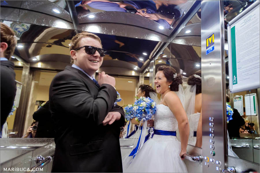 Bride and groom are laughing in the elevator, Hilton