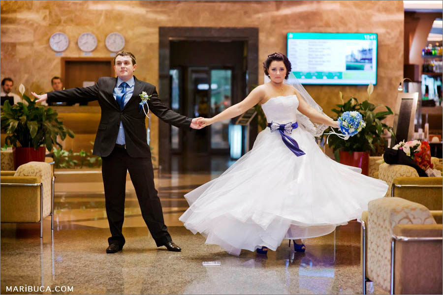 The groom and bride are training their first dance before reception in the hotel.