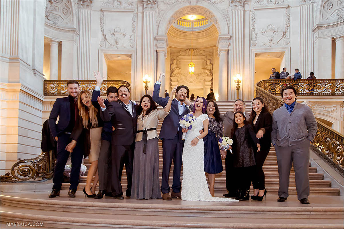 The bride and groom with their family and friends so excited about new family in the City Hall.