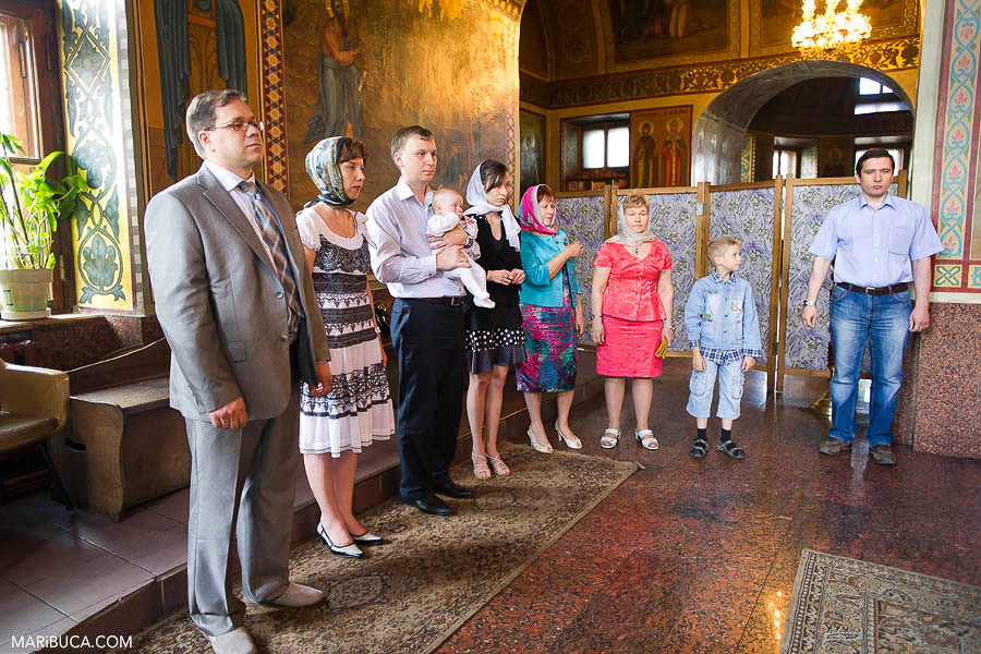 Family expecting the baptism ceremony in the christening baptism church