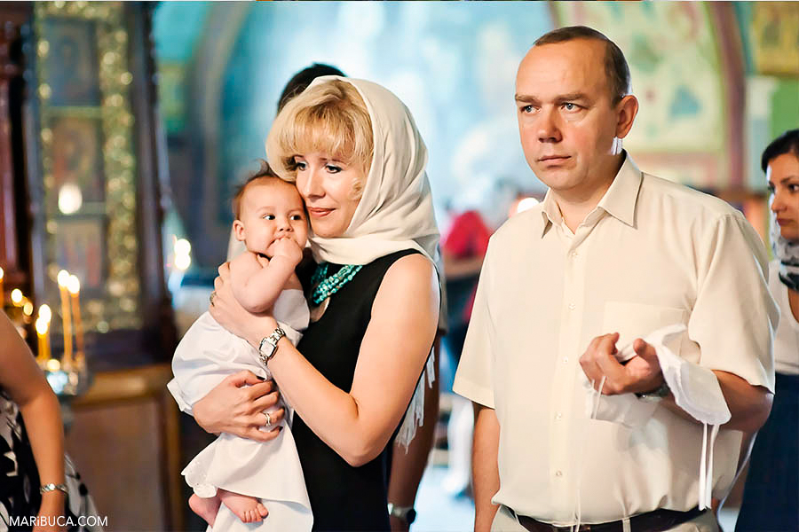 baby with Godparents in the church