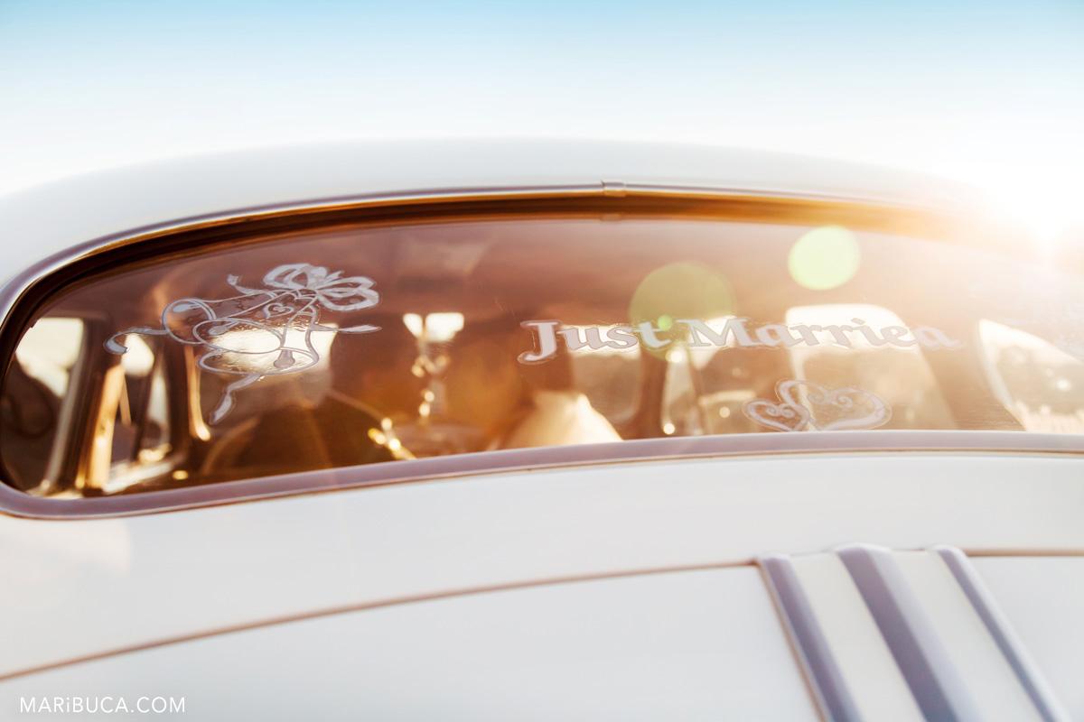 49__49-treasure-island-wedding-kissing-in-the-car-san-francisco.jpg