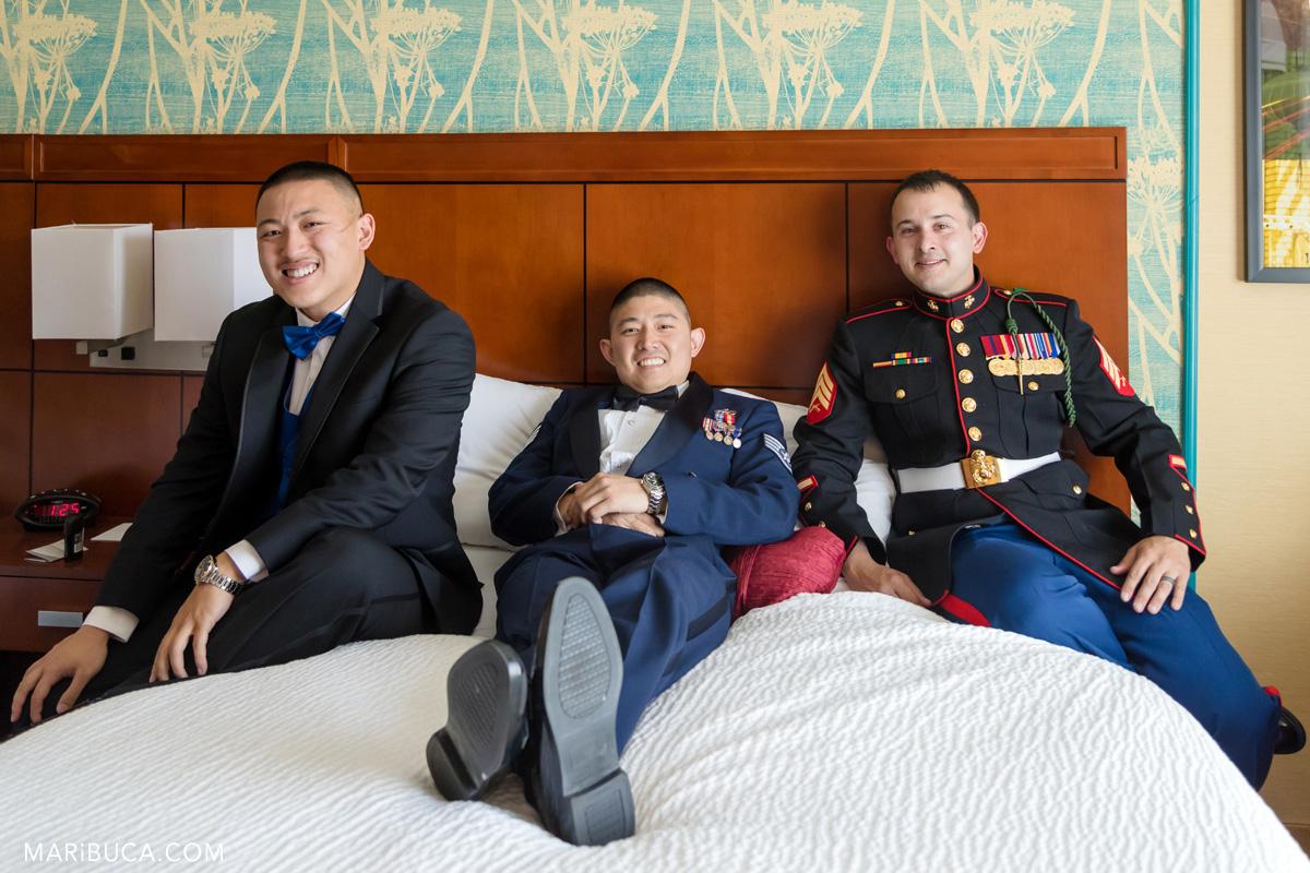 58_57-getting-ready-groomsmen-groom-lay-down-bed-wedding-san-jose.jpg