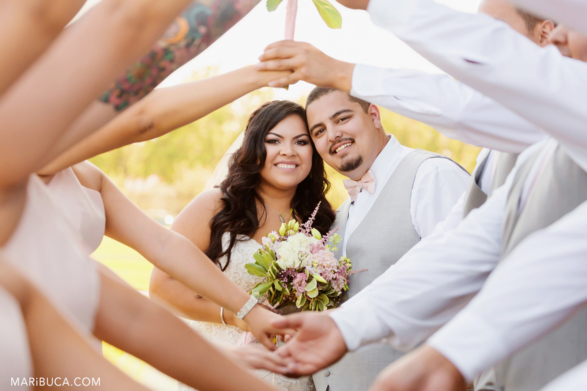 62_61-rose-garden-wedding-happy-couple-with-bridal-party.jpg