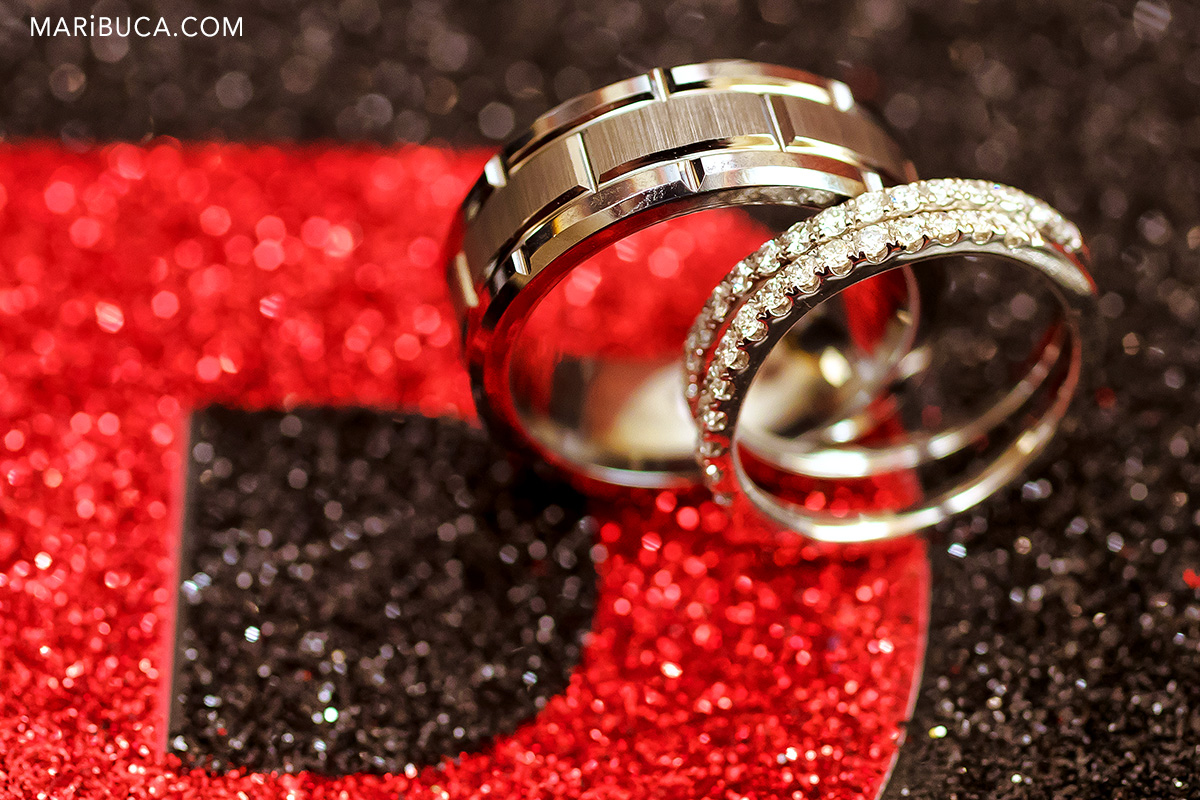 Unique Wedding rings with black and red background