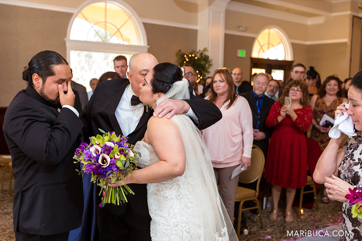 Dad kiss the daughter and groom cries in the villa montalvo saratoga