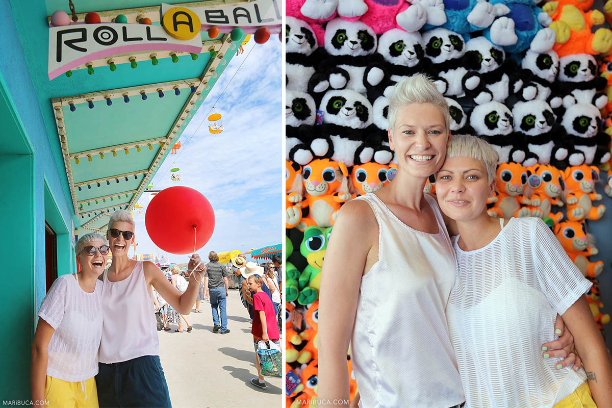 Colorful background in the Boardwalk with two amazing girls in their the elopement wedding.